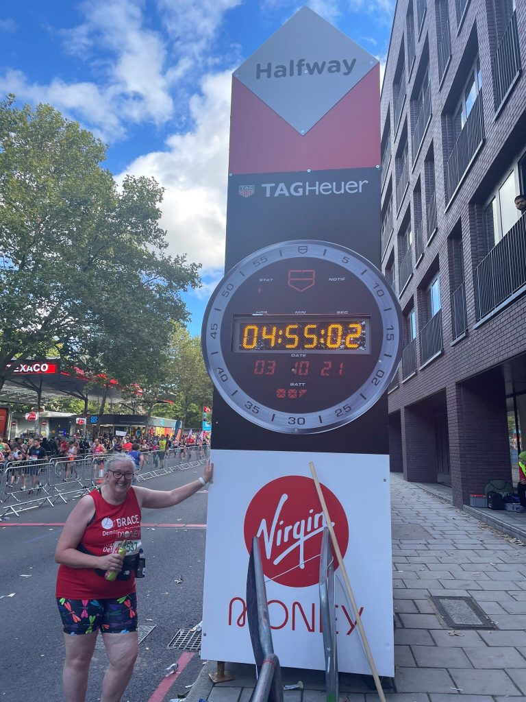 Lucy is stood by the half way point of the marathon.