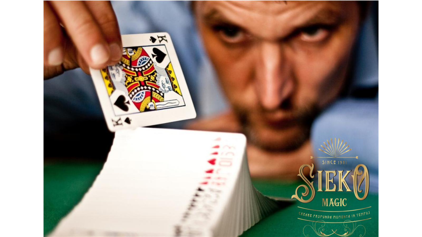 Magician Sieko is resting his head on his hand whilst looking at a pack of cards.